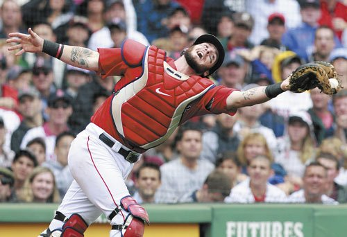 NICE CATCH: Boston catcher Jarrod Saltalamacchia makes the catch on a pop foul by Tampa Bay's Kelly Shoppach in the seventh inning of the first game of a doubleheader Tuesday in Boston.