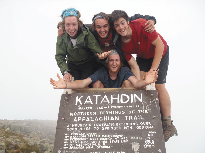 WE MADE IT: From top l-r, Jim McCullum, Nate Pronovost, Damian Melnicove and Austin Langsdorf, bottom center, celebrate the recent completion of their trek along the Appalachian Trail at the peak of Mt. Katahdin.