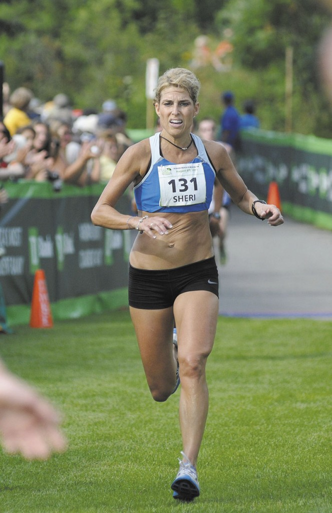 TOUGH RACE: Sheri Piers crosses the finish line to win her second Maine women's title at the Beach to Beacon 10K Saturday in Cape Elizabeth.