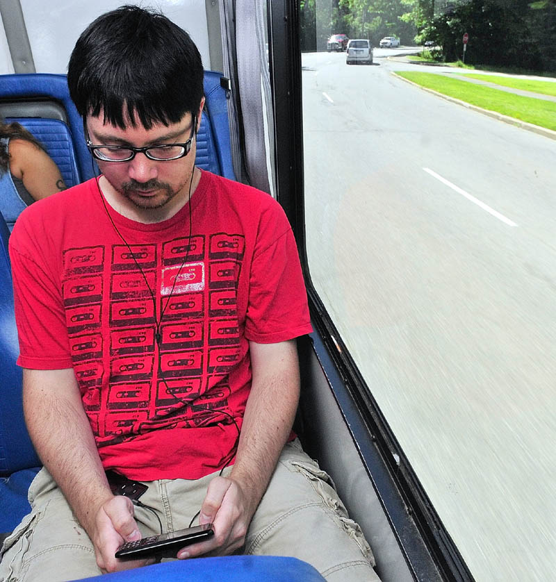 ON THE BUS: Ronald James catches the Kennebec Explorer from from Goggin's IGA in Randolph and takes it to his job in Augusta.