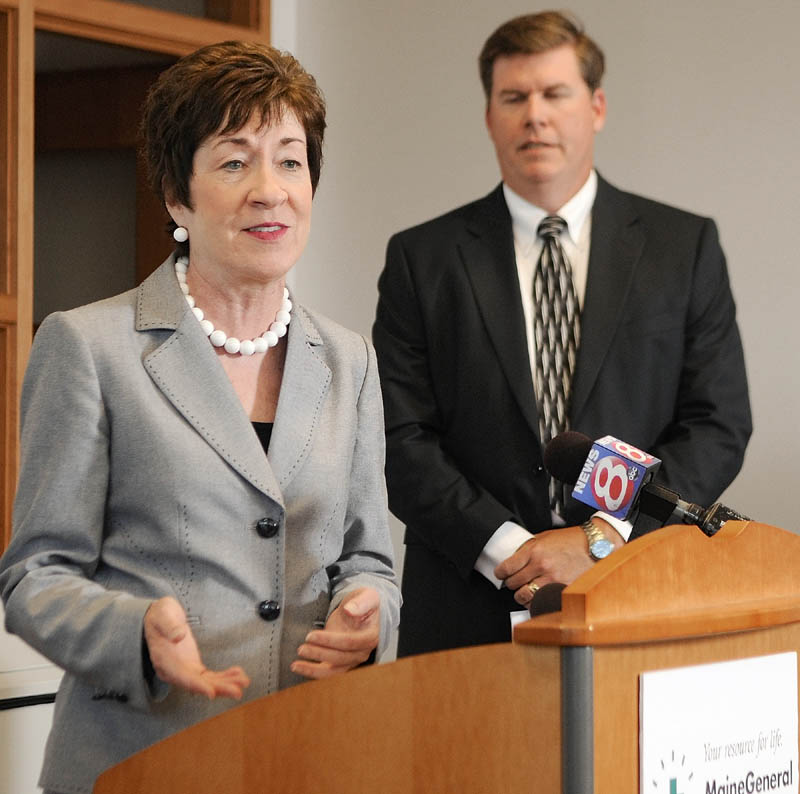Maine General Medical Center Chief Executive Officer Chuck Hays, right, listens as U.S. Sen. Susan Collins, R-Maine, announces funding for exit 113 on Friday at the Harold Alfond Center for Cancer Care, one of the major facilities that motorists will find easier to access via the new ramps.