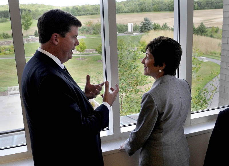 Maine General Medical Center Chief Executive Officer Chuck Hays, left, talks to U.S. Sen. Susan Collins, R-Maine, about construction of the new regional hospital being built outside the windows of the Harold Alfond Center for Cancer Care on Friday in Augusta. Sen. Collins had earlier announced federal funding for work on exit 113.