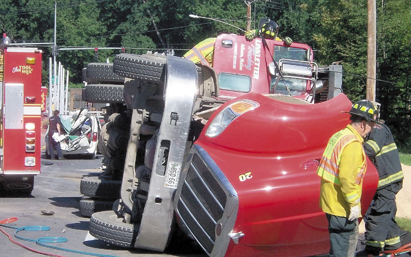 Emergency responders are seen at a fatal crash on Wednesday in Farmington involving a tractor-trailer and a minivan. A 12-year-old girl from Connecticut was killed, police said.