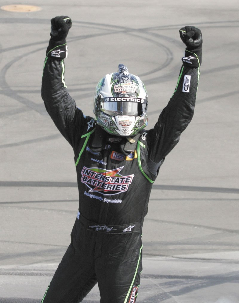 MASKED MAN: Kyle Busch celebrates his victory in the NASCAR Sprint Cup Series race Sunday at Michigan International Speedway in Brooklyn, Mich.