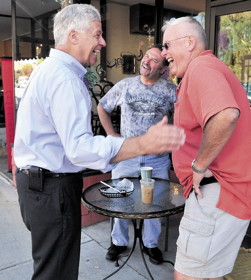 U.S. Rep. Mike Michaud, D-2nd District, left, shares a light moment with Marc Bizier, center, and Kelly Wynn on Main Street in Waterville during a walking tour on Wednesday.