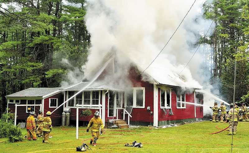 ADDED DIFFICULTY: The metal roof on this Wings Mills Road home in Mount Vernon made it difficult for firefighters to vent the smoke and heat, which complicated efforts to extinguish the blaze, Mount Vernon Deputy Fire Chief Tony Dunn said Tuesday.