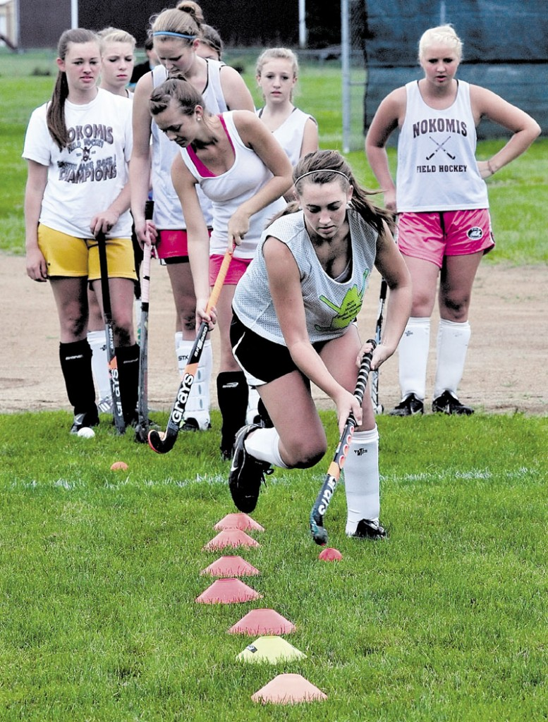 Nokomis Regional High School field hockey player Marissa Shaw, front, practices with other players on Monday.