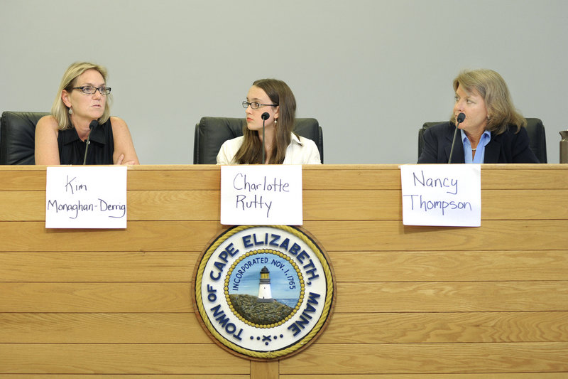 Democrat Kim Monaghan-Derrig, left, and Republican Nancy Thompson, right, appear at a recent candidates forum in Cape Elizabeth. At center is moderator Charlotte Rutty, a senior at Cape Elizabeth High School.