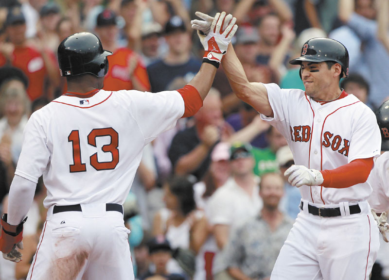 BIG DAY: Jacoby Ellsbury, right, celebrates with Carl Crawford (13) after hitting a three-run home run in the fourth inning of the Boston Red Sox 10-4 win over the New York Yankees on Saturday at Fenway Park in Boston.