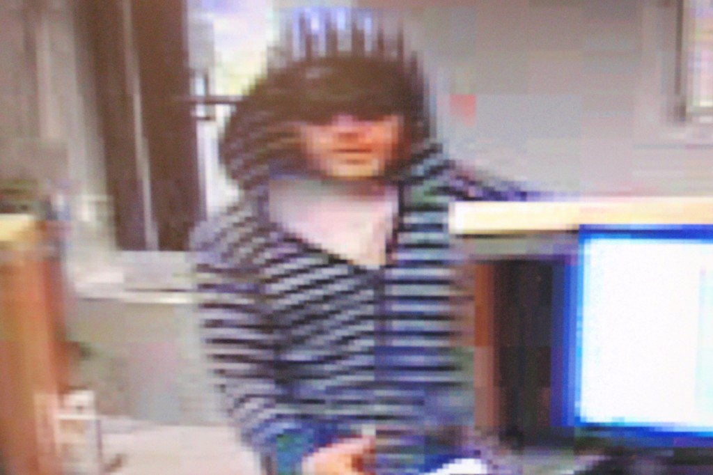 The man suspected of robbing the Winslow Community Federal Credit Union Thursday morning is seen on a security video image.