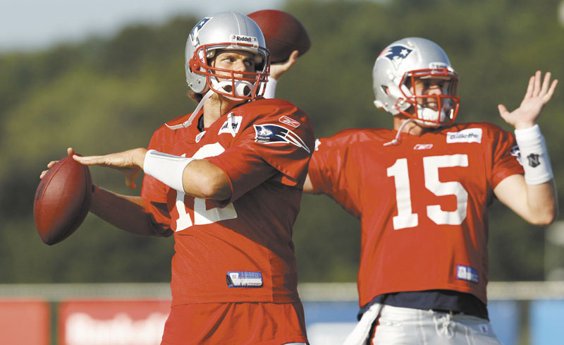 GETTING READY: New England Patriots quarterbacks Tom Brady, left, and Ryan Mallett (15) throw during practice Thursday in Foxborough, Mass.