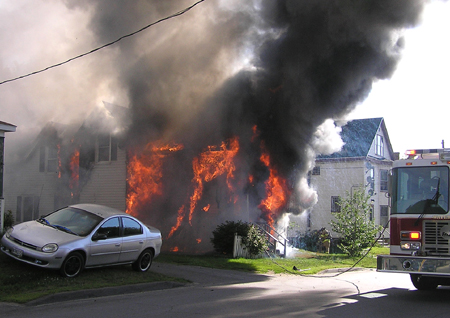 A house on Oak Street in Waterville is consumed by fire Tuesday morning.