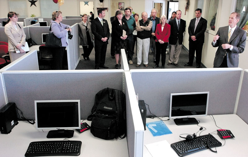 IN THE BEGINNING: Global Contact Services President and Chief Executive Officer Greg Alcorn gives a tour of the new call center during a 2008 grand opening at the Somerset Plaza in Pittsfield. The company closed the center last week.