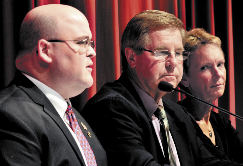 DEBATING: Waterville mayoral candidates Andrew Roy, left, Dana Sennett, center, and Karen Heck participate in a forum Monday at Thomas College in Waterville.