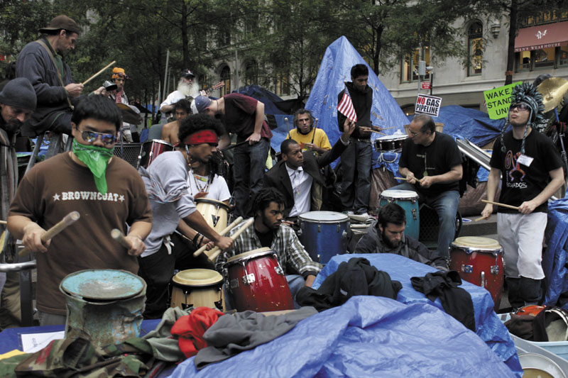 PEACEFUL: Occupy Wall Street protesters play drums and other percussion instruments at Zuccotti Park in New York on Wednesday.