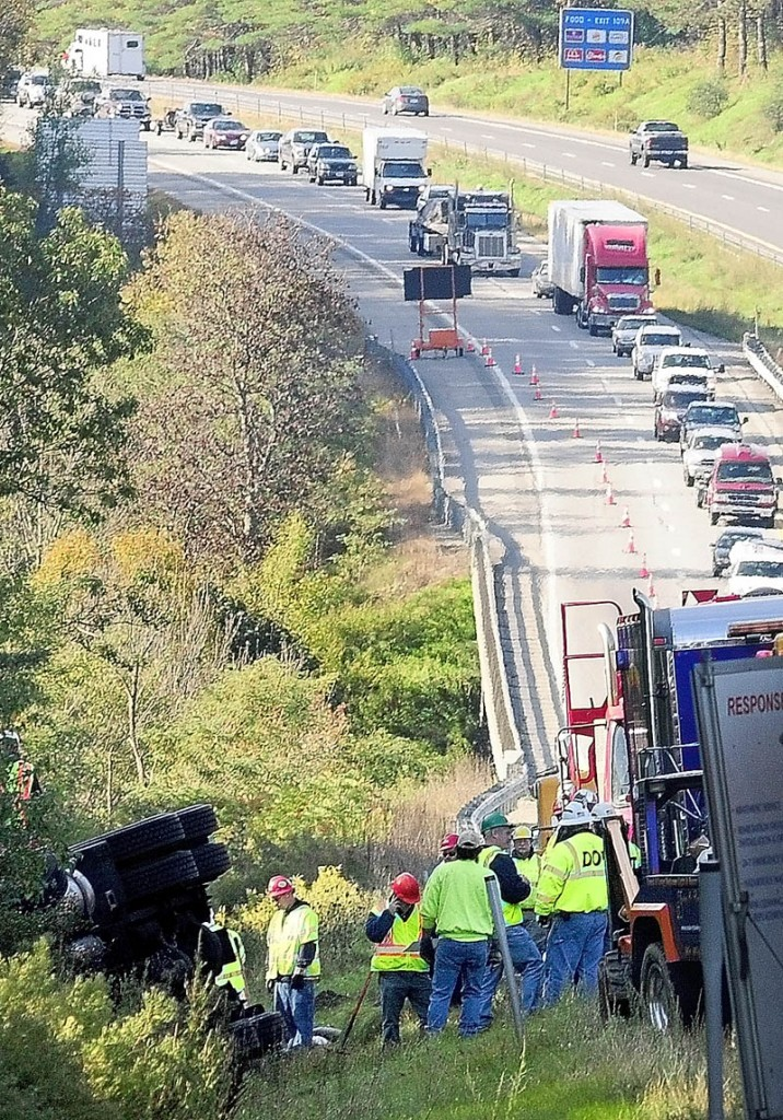LONG COMMUTE: Northbound traffic backs up as vehicles move into one lane to go around a tanker truck crash Friday on Interstate 95 between the Bond Brook overpass and exit 112 in Augusta. Traffic was backed up for as much as 8 miles Friday afternoon, nearly 13 hours after the crash.