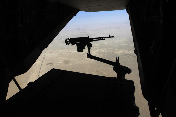 A machine gun is attached to the tail ramp of a U.S. military Osprey helicopter flying a mission in Helmand province, southern Afghanistan, recently.