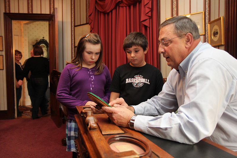 During a food drive at the Blaine House in Augusta on Saturday, Gov. Paul LePage showed William Harvey, 7, of Winslow and his nine-year-old sister Lilly a note written by President Abraham Lincoln to Speaker of the House James G. Blaine that was penned a week before Lincoln was assassinated. LePage and his wife, Ann, opened the Blaine House to guests as part of a food drive to help needy Mainers. The drive will occur again the next two Saturdays from 11 a.m. to 2 p.m. Guests can drop off non-perishable food items and chat with Maine's first family.