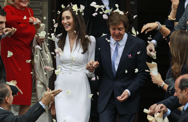 Former Beatle Paul McCartney and American heiress Nancy Shevell exit Marylebone Town Hall in central London after they were married today. Shevell, 51, is McCartney's third wife. They were engaged earlier this year. The couple met in the Hamptons in Long Island, N.Y., shortly after the singer's divorce from Heather Mills in 2008.