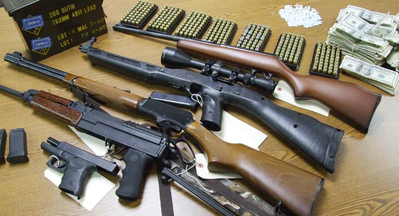 Maine State Police photo of guns seized in raid in Portland on Wednesday night.
