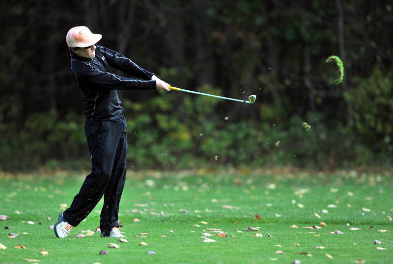 Luke Ruffing of Maranacook High School swings for the green on the 1st hole Saurday on the Tomahawk course at Natanis Golf Course in Vassalboro.