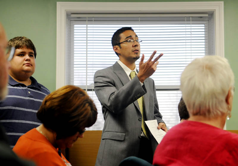 TRYING TO RESOLVE PROBLEMS: New Regional School Unit 2 superintendent Virgel Hammonds addresses the Richmond selectmen meeting Wednesday. Hammonds — who started the job in July after moving to central Maine from California — is traveling to town halls and private homes to meet as many people as he can to try to improve communication in a splintered district where two towns are considering withdrawal.