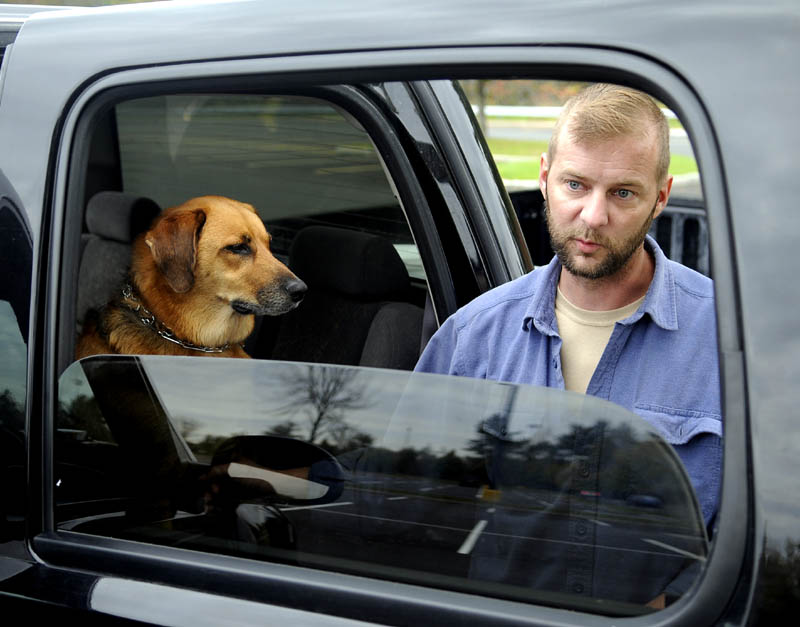Aaron Rollins, a disabled veteran, is living in his truck in Augusta to be with his dog.