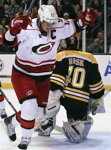 Carolina Hurricanes center Eric Staal (12) celebrates his goal against Boston Bruins goalie Tuukka Rask (40) of Finland in the third period of an NHL hockey game Tuesday in Boston.
