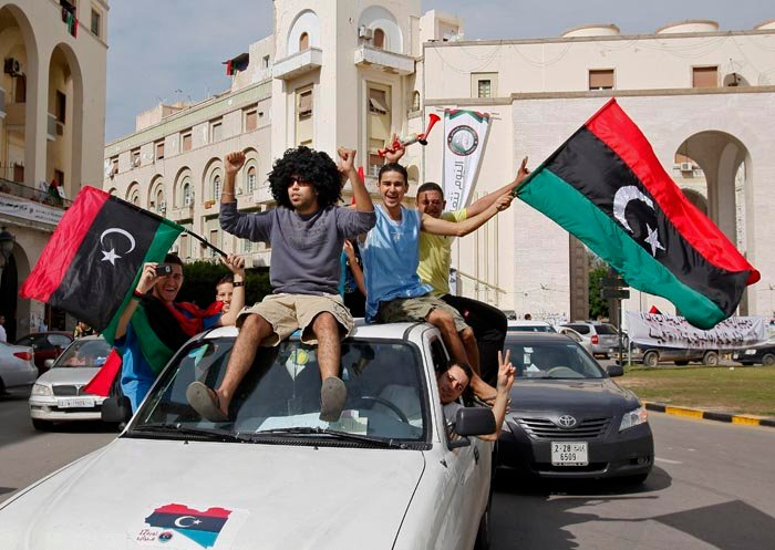 Libyans in Tripoli celebrate Moammar Gadhafi's death today.