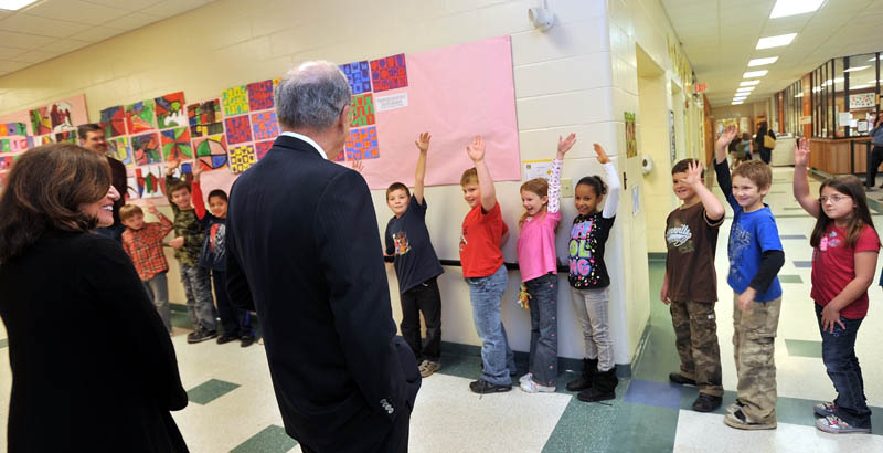 BIG HELLO: Second-grade students wave to former Sen. George Mitchell and his sister Barbara Atkins during a tour of the George Mitchell Elementary School Friday in Waterville.