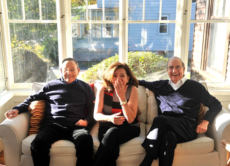 FAMILY FUN: Siblings Paul Mitchell, left, Barbara Atkins and Sen. George Mitchell enjoy a light moment Friday at Atkins' Waterville home.