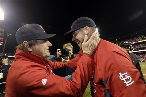 St. Louis Cardinals manager Tony La Russa, left, celebrates with starting pitcher Chris Carpenter after Carpenter pitched a three-hit shutout in Game 5 of the NLDS Friday in Philadelphia. The Cardinals beat the Phillies 1-0 to win the series 3-2.