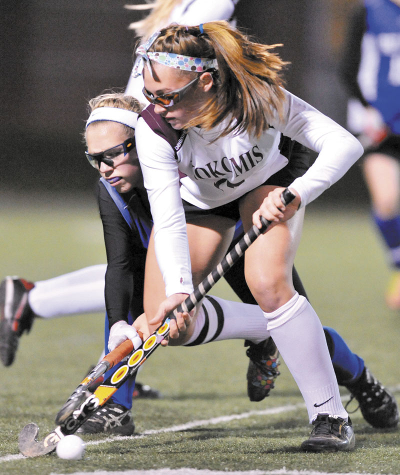 WORKING HARD: Nokomis Regional High School's Marissa Shaw, right, battles with Belfast Area High School's Madison Cummings for the ball in the first half of the Eastern B championship game Tuesday at the Weatherbee Complex in Hampden.