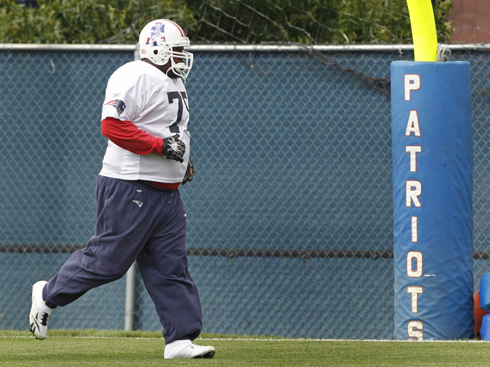 """New England Patriots nose tackle Vince Wilfork runs to the end zone during NFL football practice in Foxborough, Mass., on Wednesday. """"There's some things that we can change and some things we can play differently that allows us to be a better defense,"""" he says. """"I think everybody's striving for it."""""""