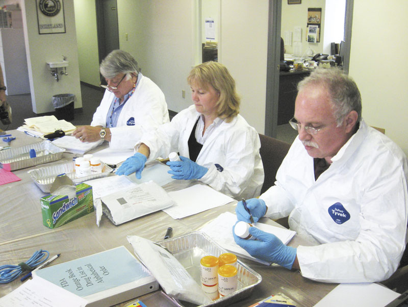 From left, project pharmacist volunteers Bill Miller, Kerry Kenney and Milton Stein inventory returns in 2009 at an undisclosed location. A team of state officials is about to test a potentially simple and cheap alternative to disposal of much of the state's unused drugs: Composting.