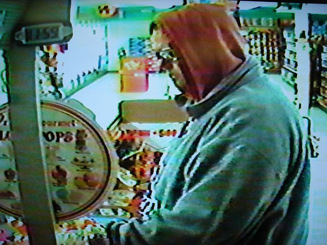 Fairfield police released surveillance photos of the man who reportedly robbed the Big Apple in Fairfield Center shortly after midnight Thursday.