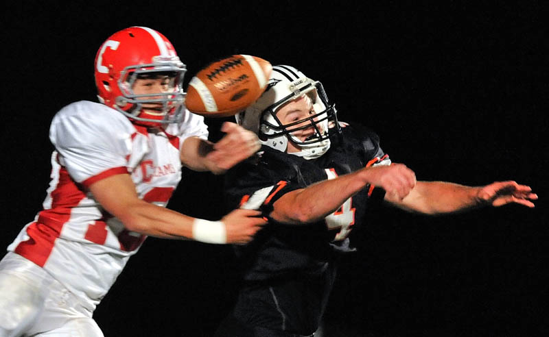 Skowhegan High School defender, Ethan Johnson, right, breaks up a pass to Cony High School receiver Chase Shostak in the end zone during the first quarter Friday night in Skowhegan.