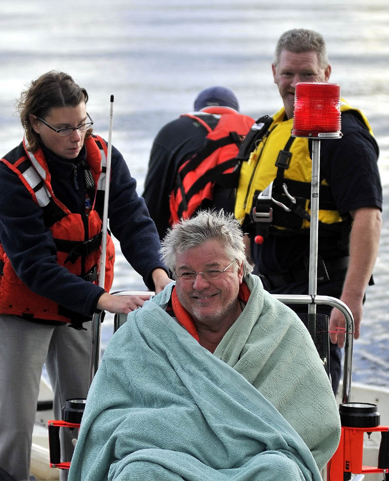 Staff photo by Michael G. Seamans Rescue personel from Oakland, Smithfield and Belgrade responded to a boat accident on North Pond just after 4pm Wednesday. The victim was transported to Inland Hospital in Waterville.