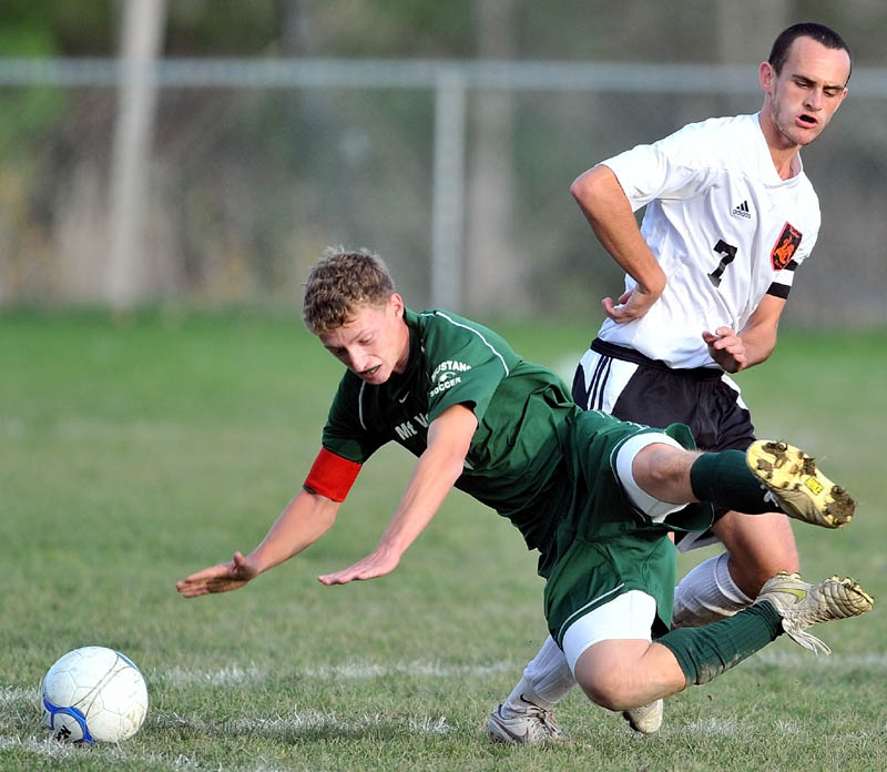 BRACE YOURSELF: Mt. View High School's Aaron Elkins, left, gets knocked to the ground by Winslow High School's Finn Ducker in an Eastern B quarterfinal game Wednesday at Kennebec Savings Bank Field in Winslow. Mt. View won 3-0.