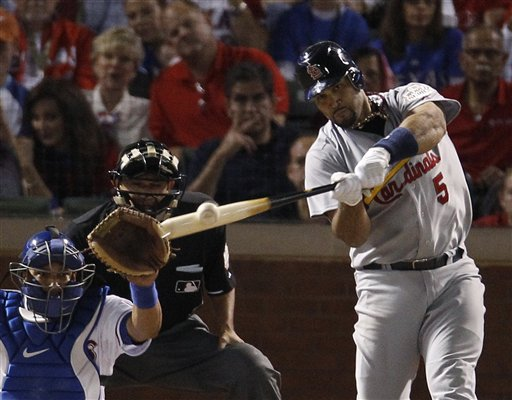 St. Louis Cardinals' Albert Pujols hits a three-run home run during the sixth inning of Game 3 of baseball's World Series against the Texas Rangers on Saturday in Arlington, Texas.