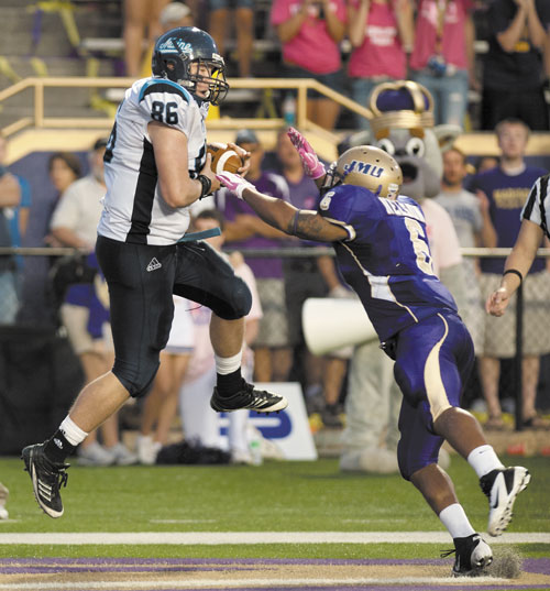 IT'S GOOD: Maine tight end Justin Perillo catches a touchdown pass as James Madison's Vidal Nelson defends in overtime Saturday in Harrisonburg, Va. Maine quarterback Chris Treister scored on a two-point conversion to give Maine the victory 25-24.