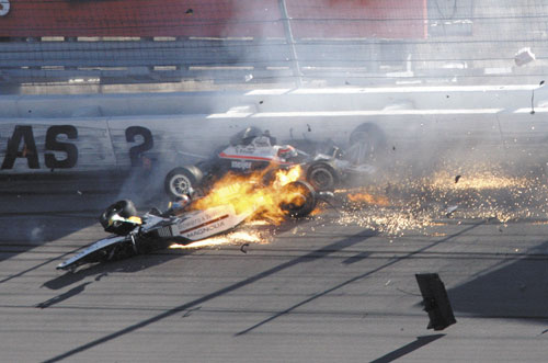 FIERY CRASH: Dan Wheldon, front left, and another driver crash during a wreck that involved 15 cars during the IndyCar Series' Las Vegas Indy 300 race Sunday at Las Vegas Motor Speedway in Las Vegas. Wheldon died after the crash.