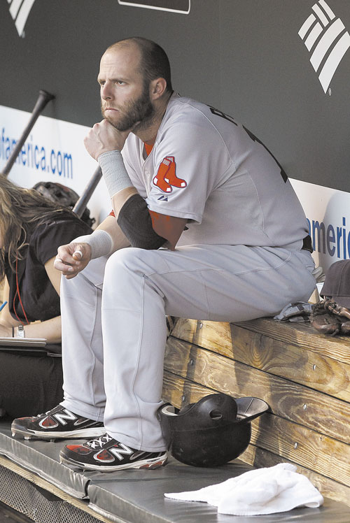 TOUGH SEASON: Boston Red Sox second baseman Dustin Pedroia sits in the dugout before a game against the Baltimore Orioles last week in Baltimore.