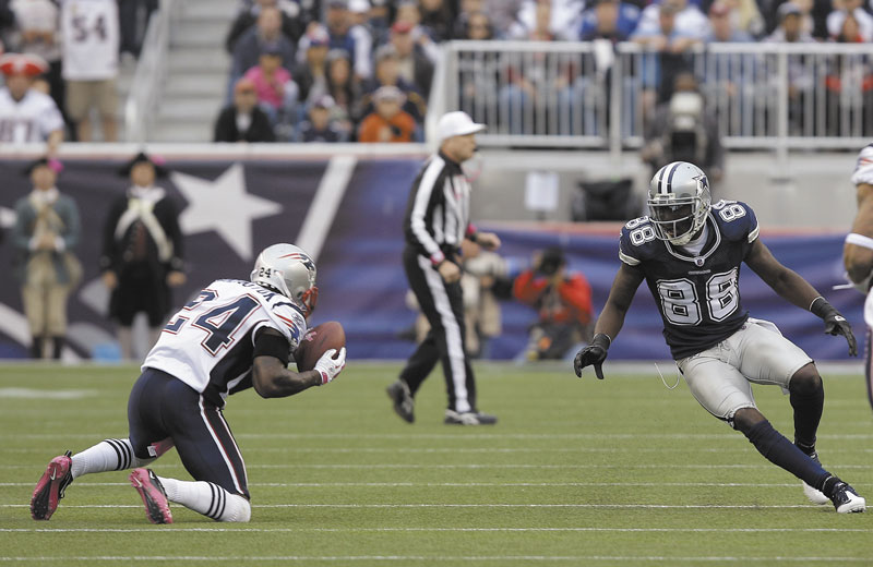 ANOTHER INTERCEPTION: Kyle Arrington, left, of the Patriots picks off a Tony Romo pass during Sunday's game against the Dallas Cowboys in Foxborough, Mass.