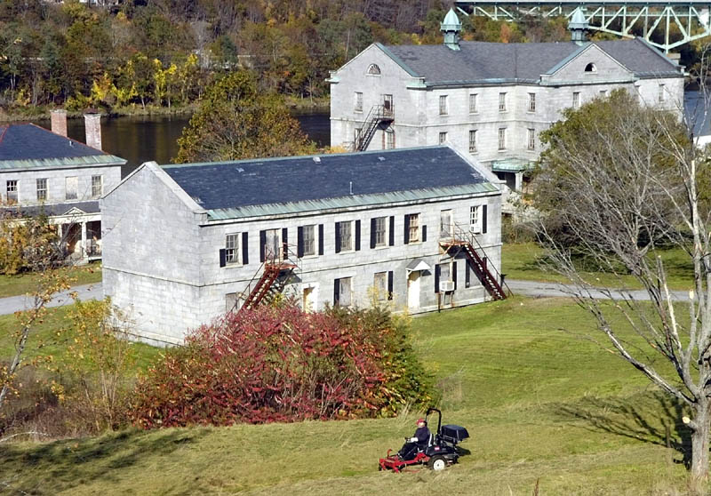 A lawnmower cuts the grass at the Kennebec Arsenal this week in Augusta.