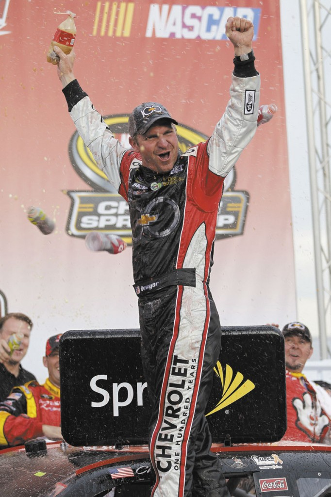 LET'S GET CRAZY: Clint Bowyer celebrates in victory lane after winning the Good Sam Club 500 Sunday at Talladega Speedway in Talladega, Ala.