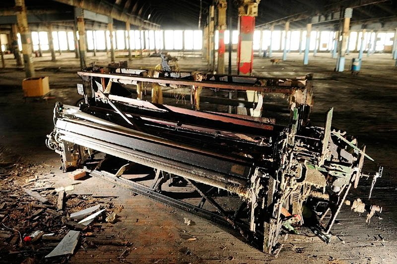 A derelict loom sits on the second floor of the Bates Mill No. 5 in Lewiston. It is the proposed site of a casino.