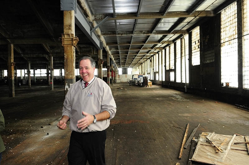 Lewiston city official Lincoln Jeffers leads a tour of the Bates Mill No. 5 in Lewiston, the proposed site of a casino.