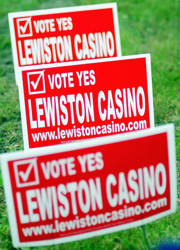 Campaign signs on Main Street support a referendum that would allow the The Bates Mill No. 5 in Lewiston be turned into a casino.