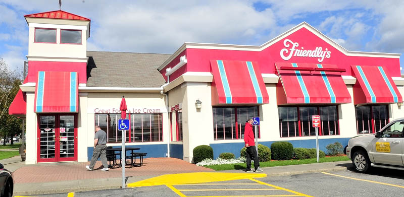 Customers walk outside the Friendly's restaurant on Upper Main Street in Waterville on Wednesday. The store, along with the one in Augusta, is not one of the 63 stores nationwide that will close.
